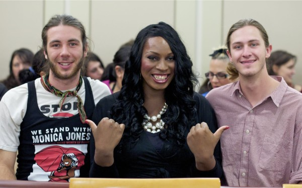 Monica Jones sits with supporters in court room, March 2014. Photo by PJ Starr.